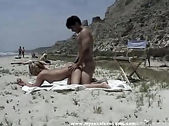 Bystanders Wait for Couple Have Lovemaking On The Beach